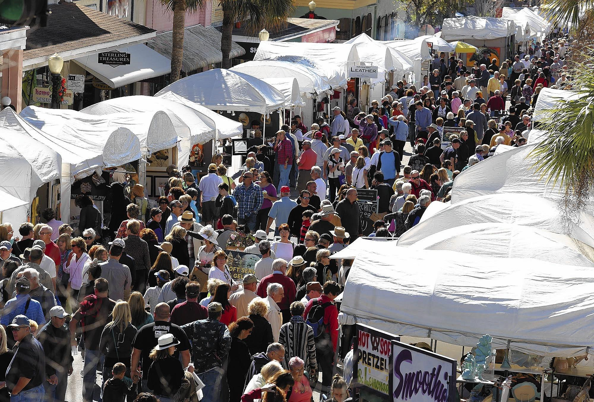 Shoppers pack Donnelly Street during last year's Mount Dora Arts Festival.
