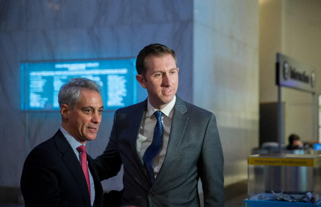 Mayor Rahm Emanuel, seen here last week with onetime aide Tom Alexander, defended the Chicago Board of Education's decision to approve more charter schools after closing neighborhood schools.