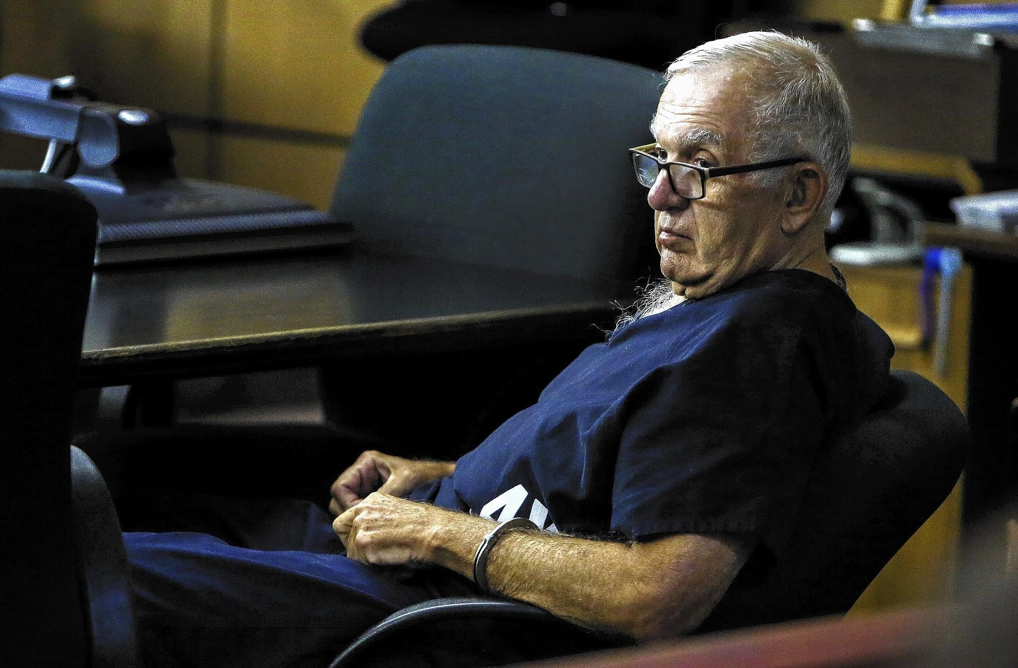 Dennis DeMartin sits in court Tuesday morning, January 28, 2014, where he was sentenced to four months in jail and nearly two months on house arrest for his actions as a juror in polo mogul John Goodman' s DUI manslaughter trial.