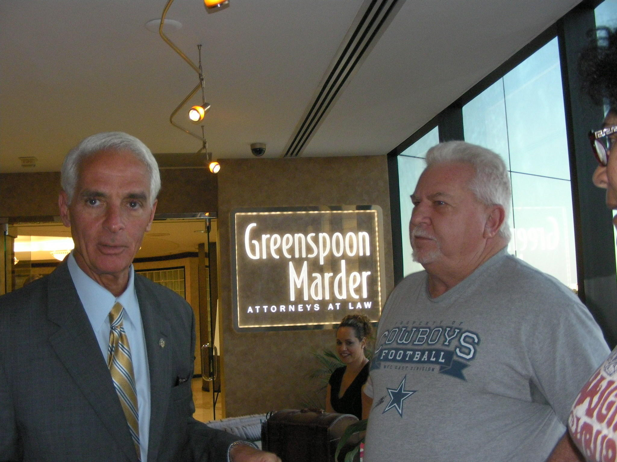 Former Gov. Charlie Crist with Dan Reynolds, 61, a Hollywood resident and North Miami Beach police officer, who was at the Greenspoon Marder law firm on Tuesday. Reynolds, a Republican, said it was really a treat to meet Crist in the lobby of the law firm and wants to see back as governor. He did such a great job when he was in. I think hes for the people. (Photo by Anthony Man)