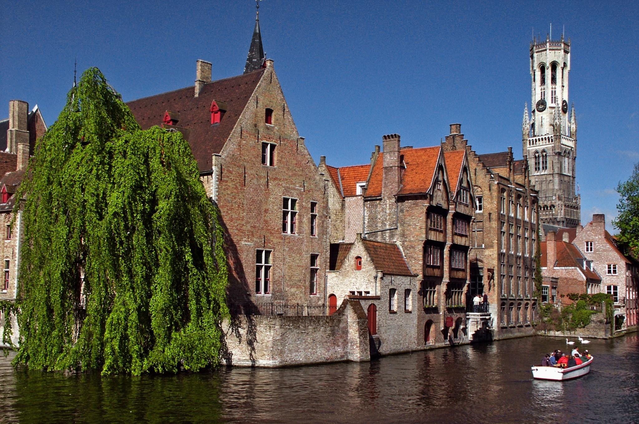 Europe motor coach tour of belgium luxembourg and the netherlands tall gabled houses line the canals of bruges belgium and give the town a publicscrutiny Image collections