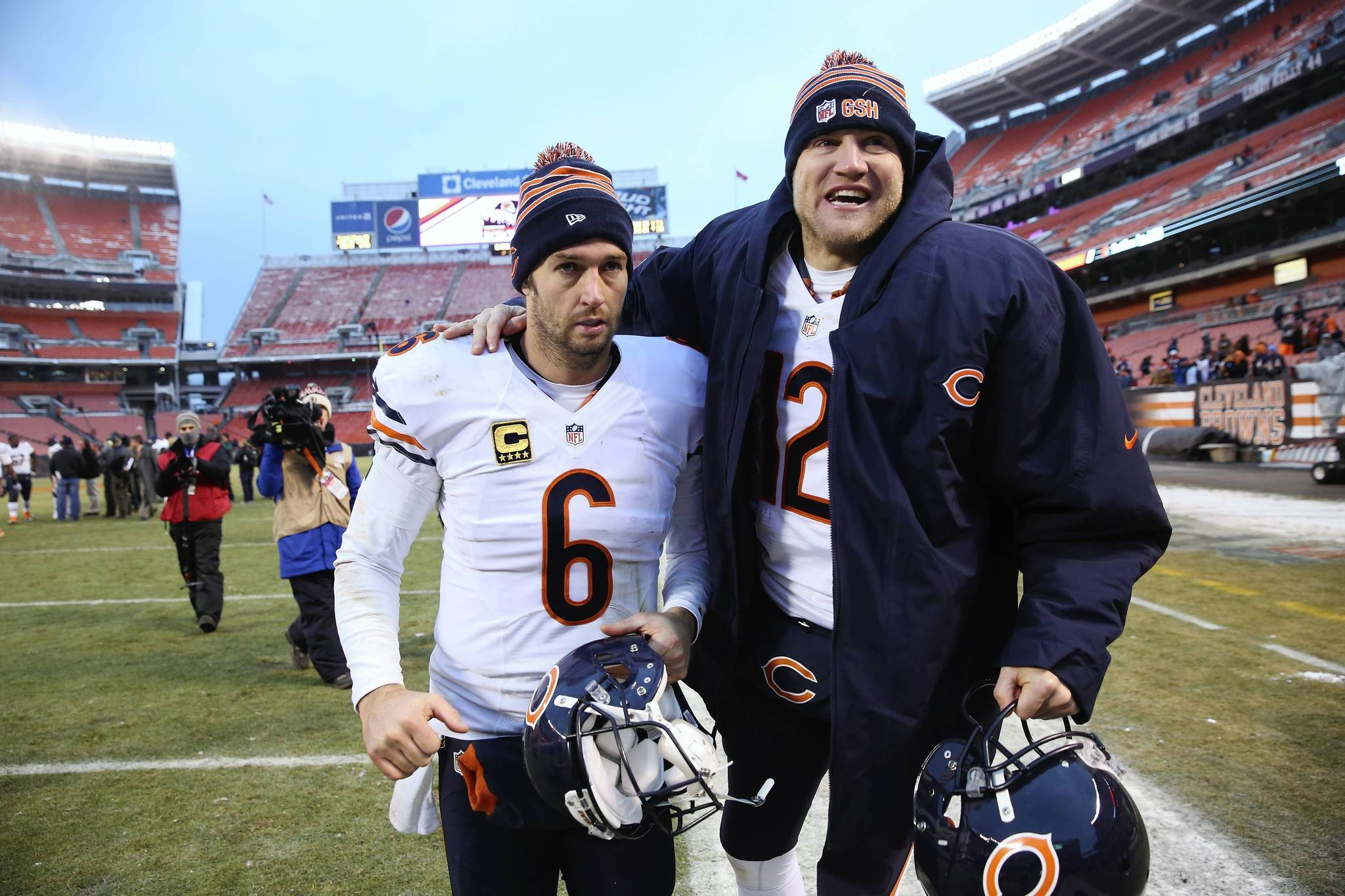 Bears quarterbacks Jay Cutler and Josh McCown leave the field together after a win over the Browns.
