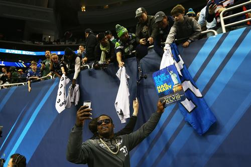 Running back Christine Michael of the Seattle Seahawks interacts with fans during Super Bowl XLVIII Media Day at the Prudential Center on Jan. 28 in Newark, New Jersey.  Super Bowl XLVIII will be played between the Seattle Seahawks and the Denver Broncos on Feb. 2.