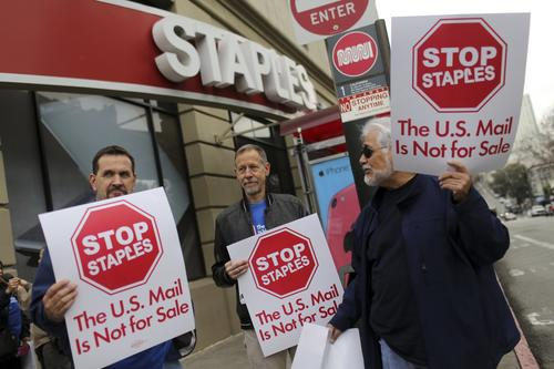 U.S. Postal Service workers in Northern California demonstrated outside a Staples store in protest against a deal to have limited postal services at Staples stores on Jan. 28.