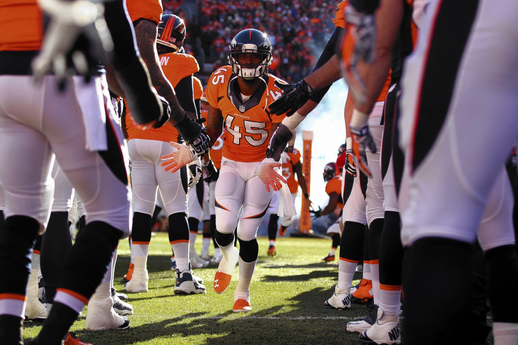 Dominique Rodgers-Cromartie #45 of the Denver Broncos runs on the field prior to their AFC Divisional Playoff Game against the San Diego Chargers at Sports Authority Field at Mile High on January 12, 2014 in Denver, Colorado.