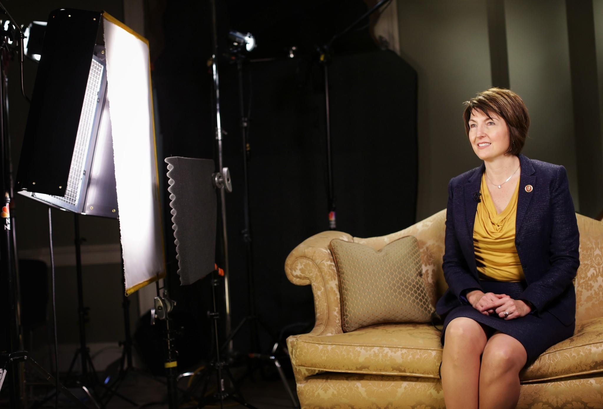 U.S. Rep. Cathy McMorris Rodgers (R-WA) sits on a couch as she prepares for responding to President Barack Obama tonight's State of the Union address January 28, 2014 on Capitol Hill in Washington, DC.