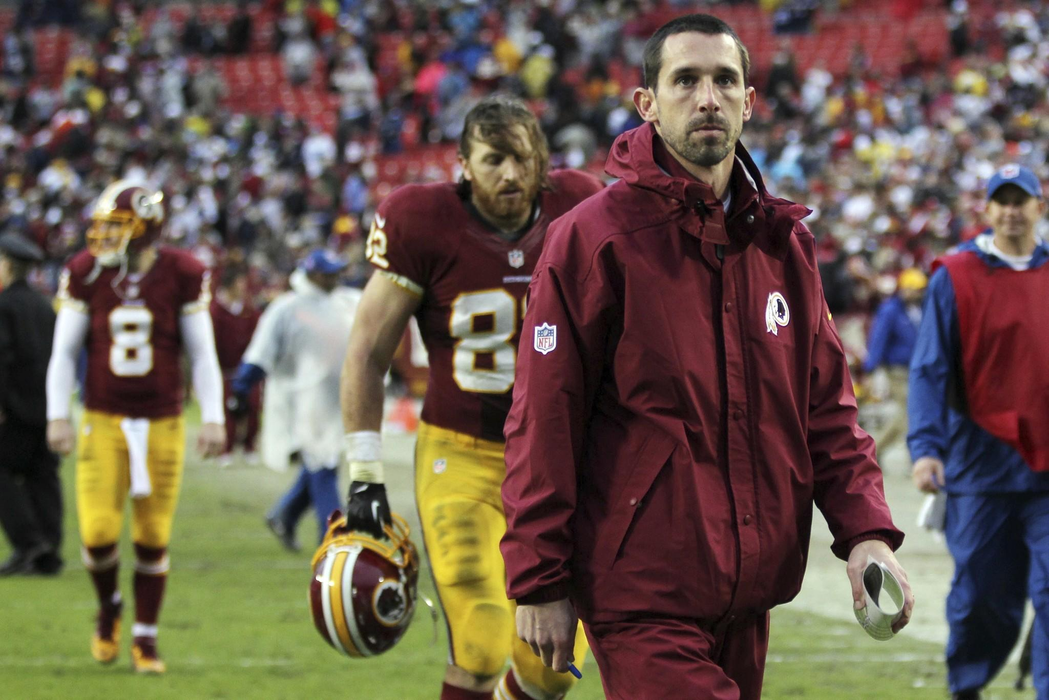 Washington Redskins offensive coordinator Kyle Shanahan walks off the field after the Redskins' game against the Dallas Cowboys at FedEx Field. The Cowboys won 24-23.