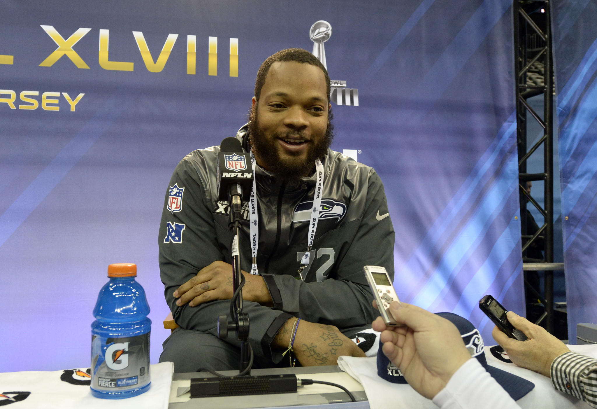 Seattle Seahawks defensive end Michael Bennett speaks during Media Day for Super Bowl XLVIII at Prudential Center.