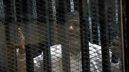 Mohamed Morsi appears in court on Egypt prison break charges