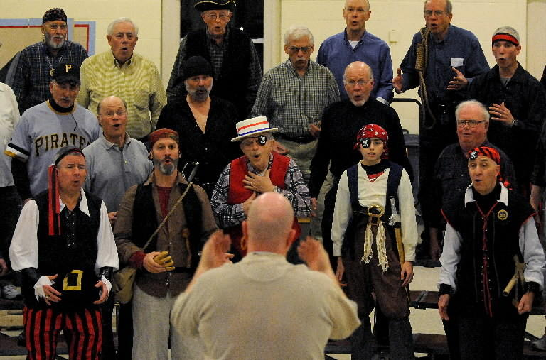 "Members of The Silk City Barbershop Chorus of Manchester rehearse for their upcoming show, ""Save Our Ship,"" at Manchester High School."