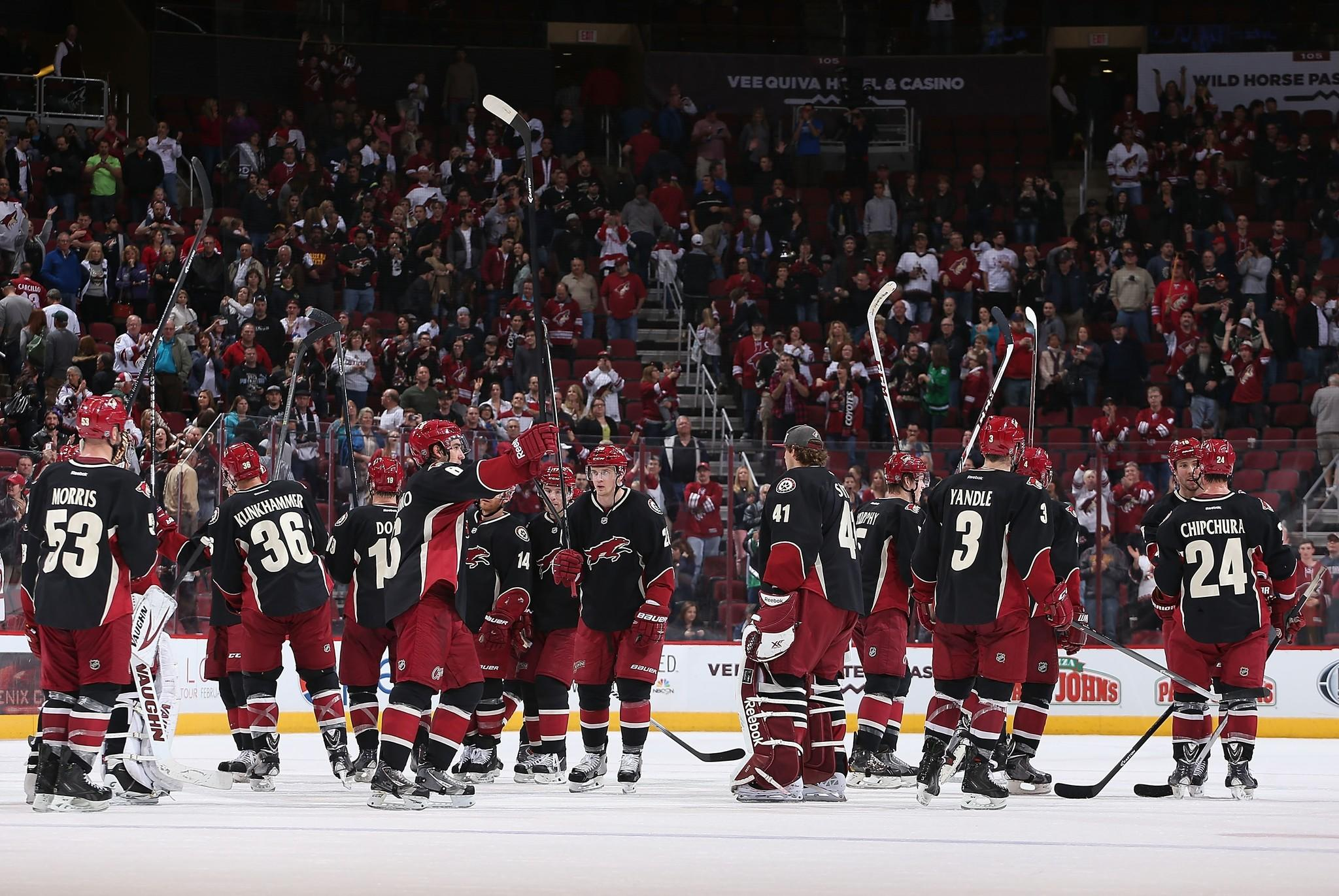 The Phoenix Coyotes salute the fans after defeating the Los Angeles Kings.