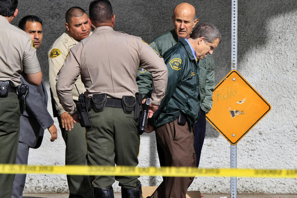 Sheriff Lee Baca visits an accident scene where a deputy was struck and critically injured by a car as he investigated a stranded or abandoned car along the Gold Line tracks in East Los Angeles.