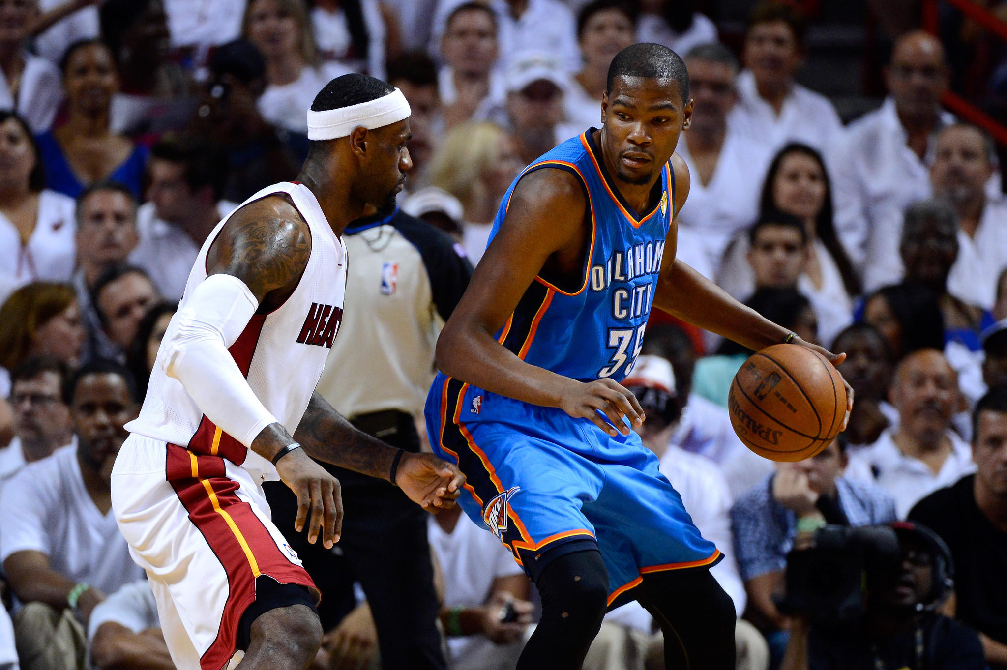 MIAMI, FL - JUNE 21: Kevin Durant #35 of the Oklahoma City Thunder moves the ball in the post in the first quarter against LeBron James #6 of the Miami Heat in Game Five of the 2012 NBA Finals on June 21, 2012 at American Airlines Arena in Miami, Florida. NOTE TO USER: User expressly acknowledges and agrees that, by downloading and or using this photograph, User is consenting to the terms and conditions of the Getty Images License Agreement.