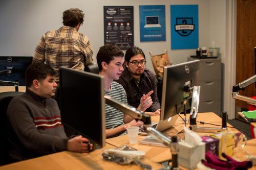Web developers Steve Raden, left, Alex Weikshar and Sascha Ishikawa work the Zooniverse space at Adler Planetarium in Chicago.
