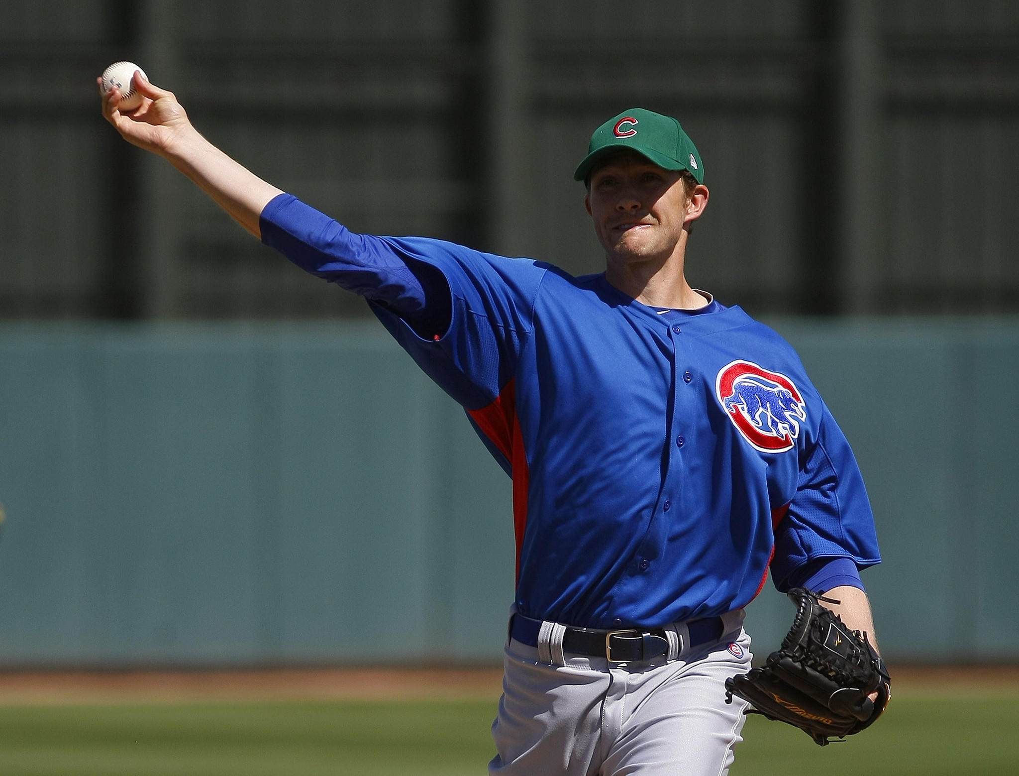 Cubs starting pitcher Scott Baker throws in the first inning during a spring training game against Oakland.