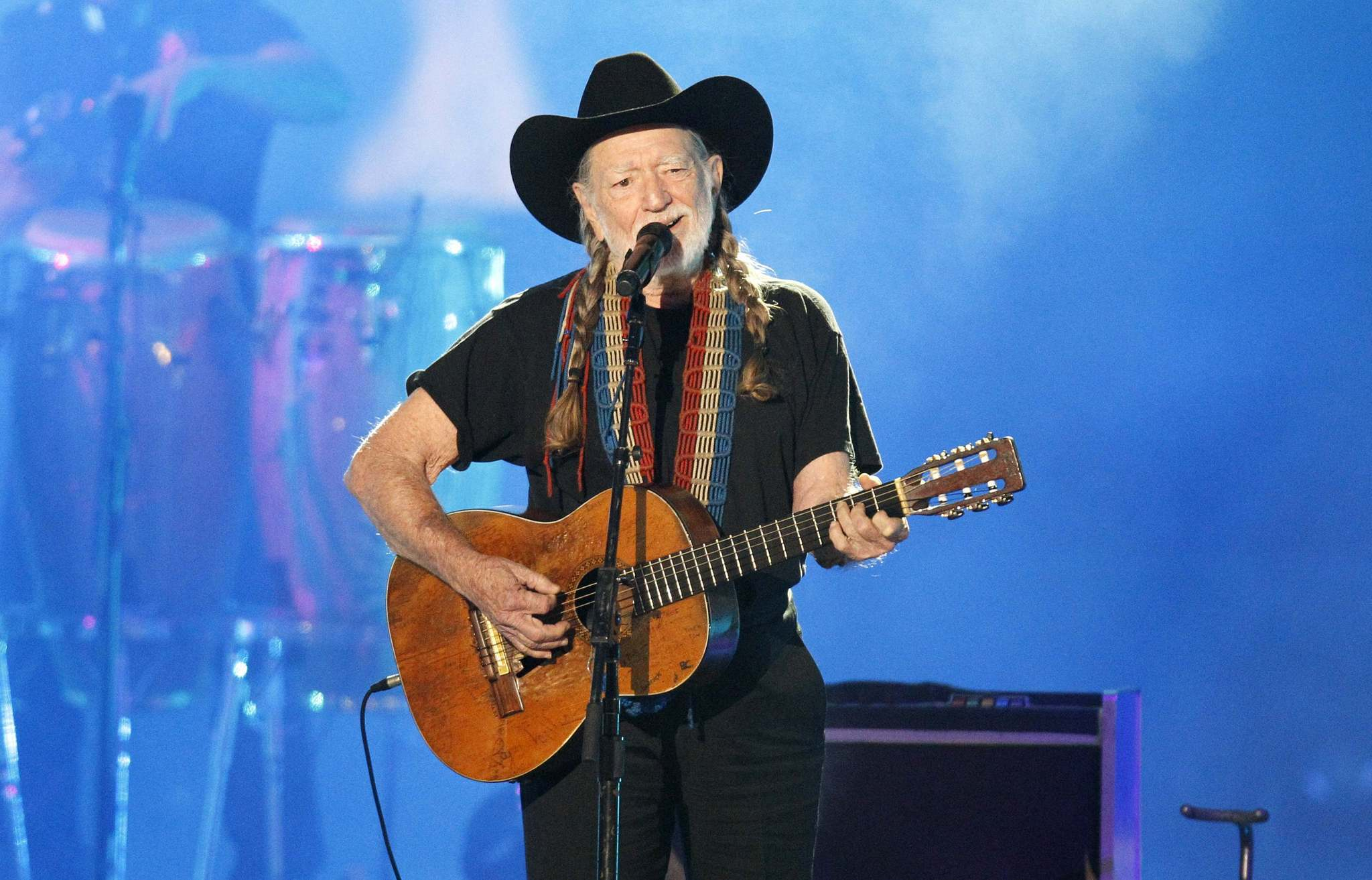 Singer Willie Nelson performs at the 2012 CMT Music Awards in Nashville, Tennessee, in this June 6, 2012, file photo. Country singer Willie Nelson's drummer broke his hip and two other band members suffered minor injuries after their bus hit a highway overpass pillar in heavy rains in East Texas early November 23, 2013 morning, according to the Texas Department of Public Safety. REUTERS/Harrison McClary/Files (UNITED STATES - Tags: ENTERTAINMENT DISASTER HEALTH) ORG XMIT: TOR600