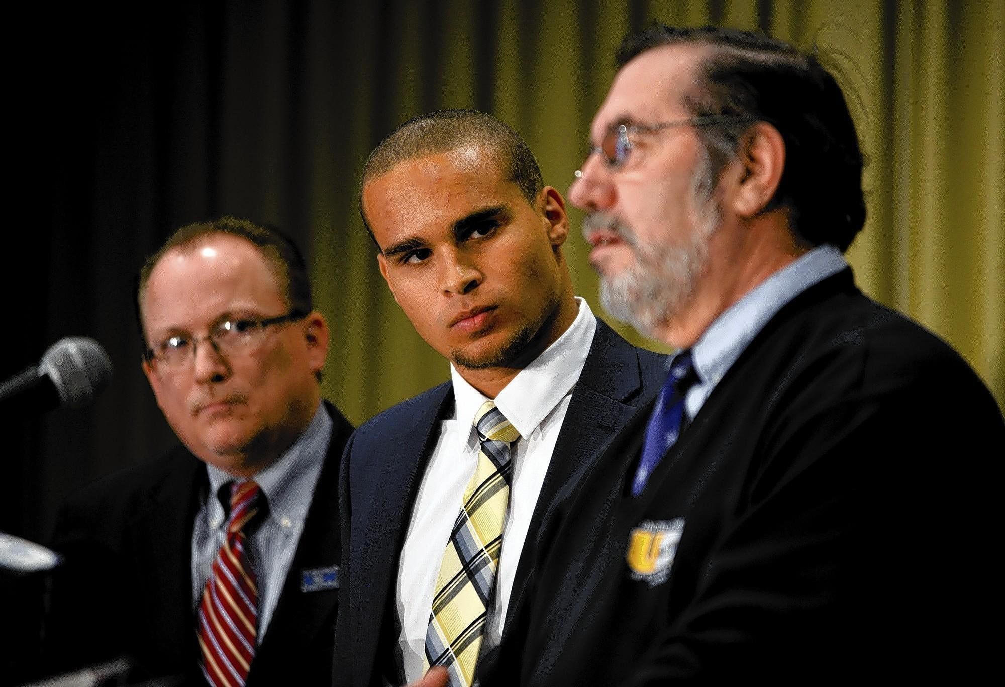 Former Northwestern University quarterback Kain Colter, center, announces plans for a football player union with United Steelworkers President Leo W. Gerard, right, and United Steelworkers national political director Tim Waters, left.