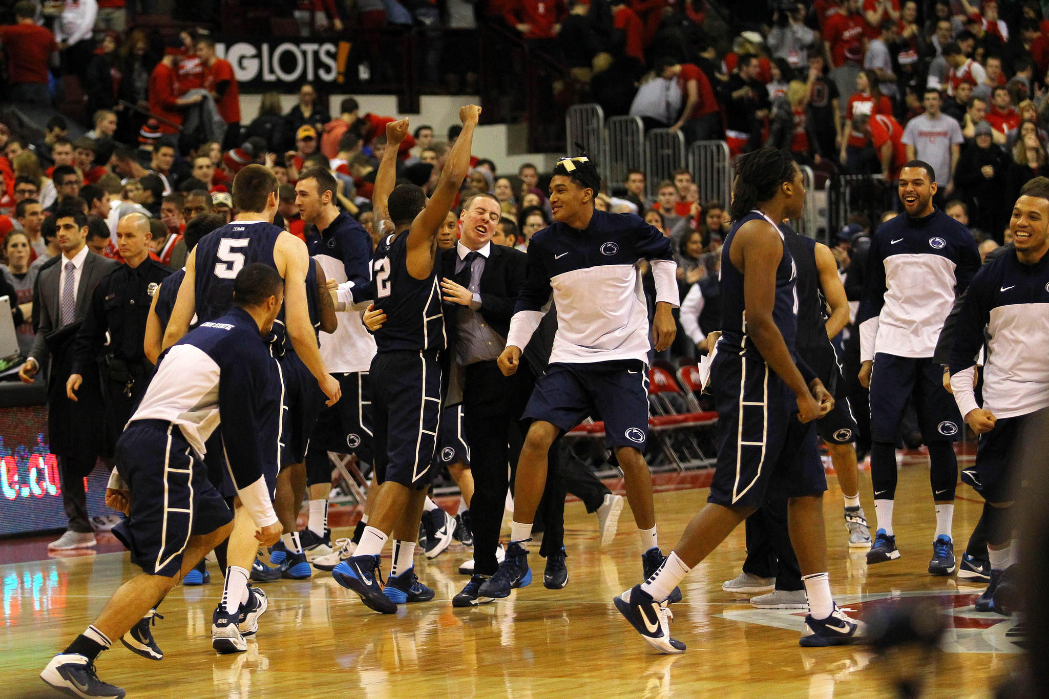 Penn State celebrates on the floor after defeating Ohio State 71-70 in overtime at Schottenstein Center.