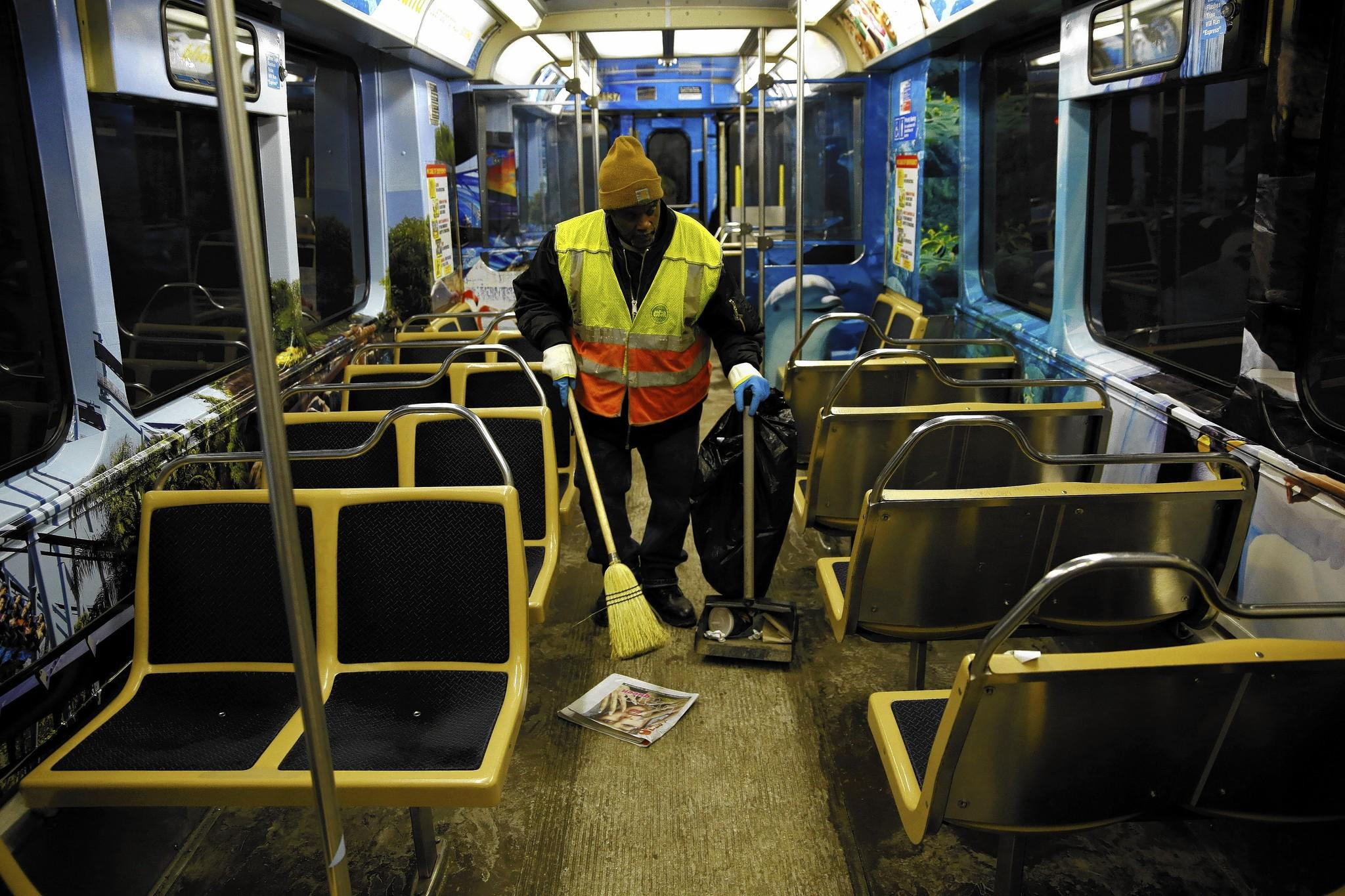 CTA worker cleans a train car this month. The agency has received more complaints of dirty rail cars since late December.