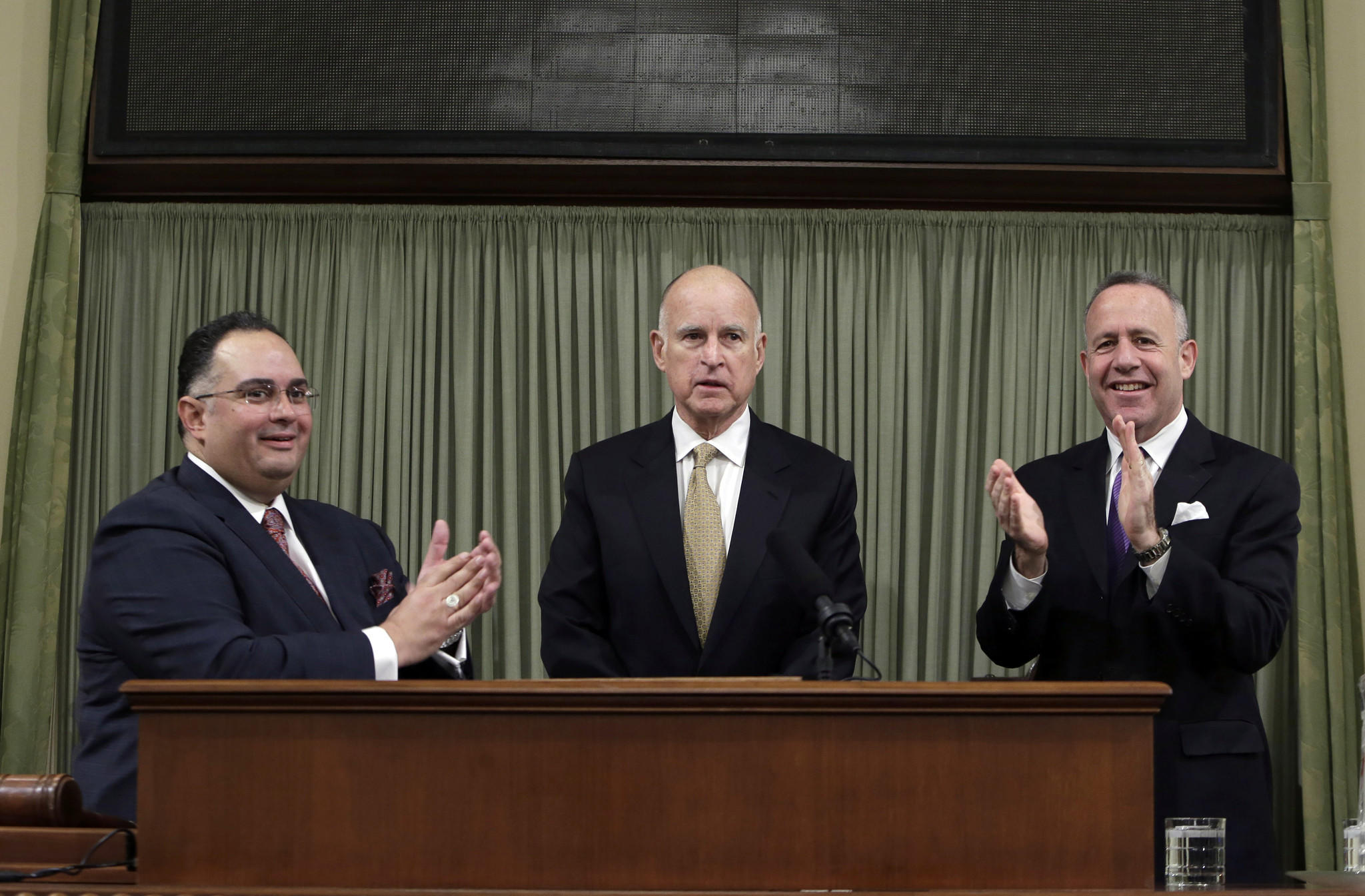 "Gov. Jerry Brown, center, with Assembly Speaker John Perez, left, and Senate President Pro Tem Darrell Steinberg, has said in the past that changing Proposition 13 would be a ""big fat loser."""