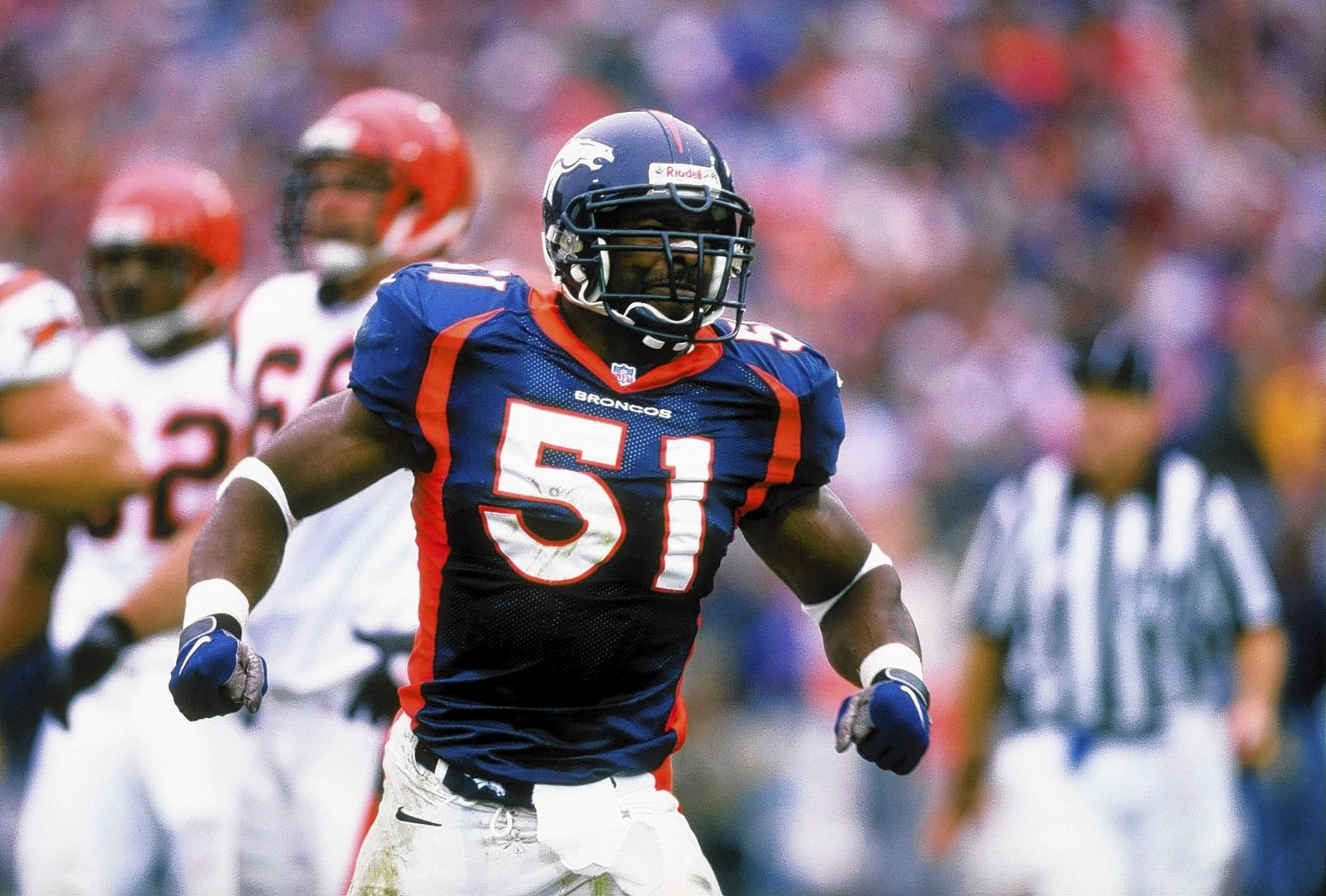 21 Sep 1997: Linebacker John Mobley #51 of the Denver Broncos celebrates during the Broncos 38-20 win over the Cincinnati Bengals at Mile High Stadium in Denver, Colorado.