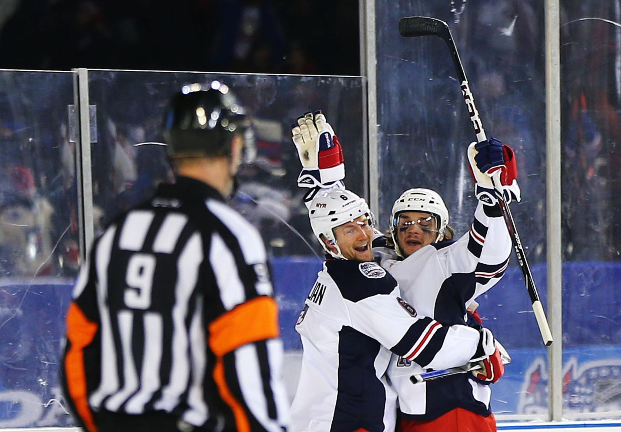 The Rangers' Daniel Carcillo celebrates his third period goal with Anton Stralman during the 2014 Coors Light NHL Stadium Series game against the Islanders at Yankee Stadium.