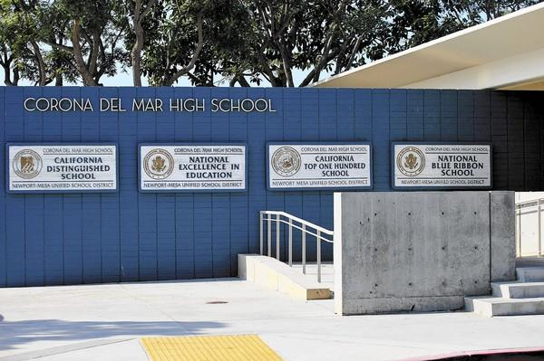 Newport-Mesa Unified District trustees voted to expel 11 students accused of participating in a detailed cheating scheme at Corona del Mar High School.