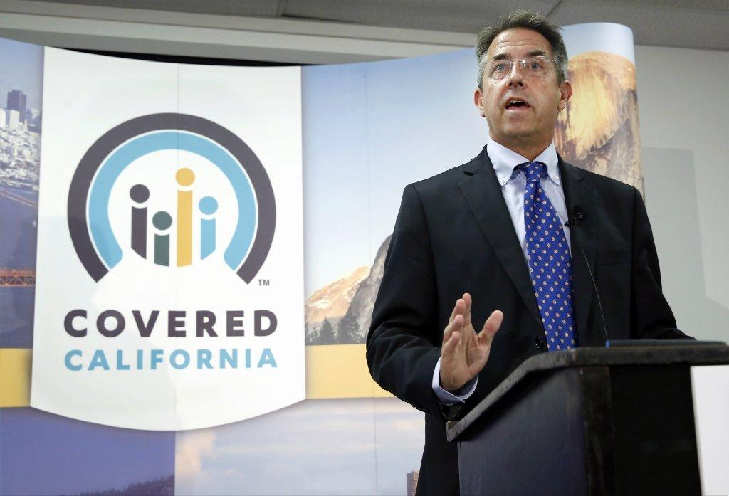 State lawmakers are criticizing the Covered California insurance exchange for allowing convicted felons to be enrollment counselors. Above, Executive Director Peter Lee discusses recent enrollment.