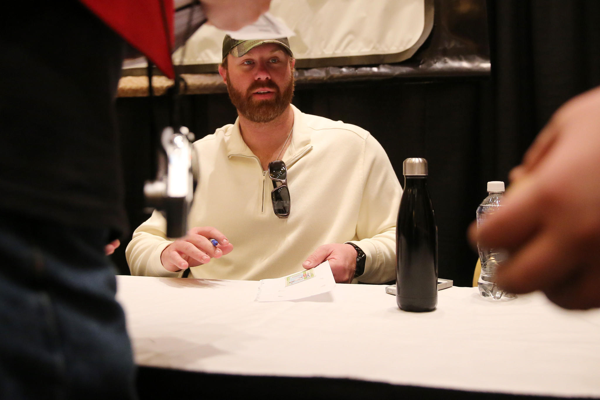 White Sox' Adam Dunn talks with a fans while signing autographs during the annual SoxFest Saturday.
