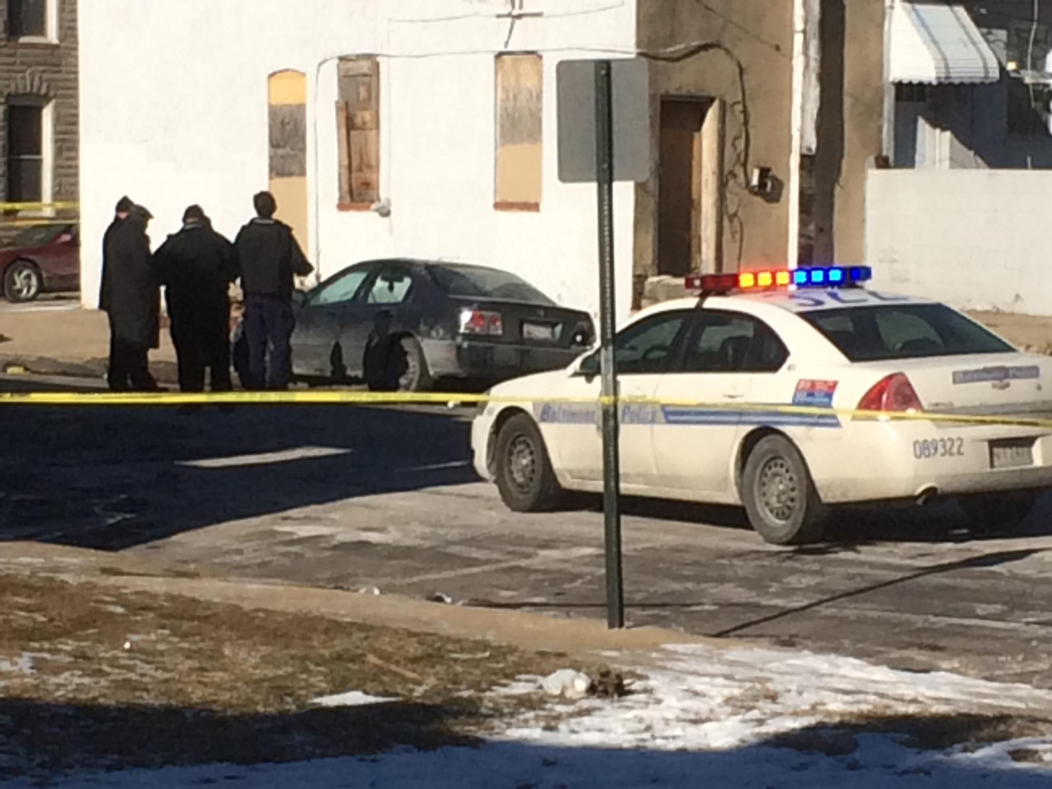 Baltimore Police investigate a car where a man and woman were found dead in Southwest Baltimore.