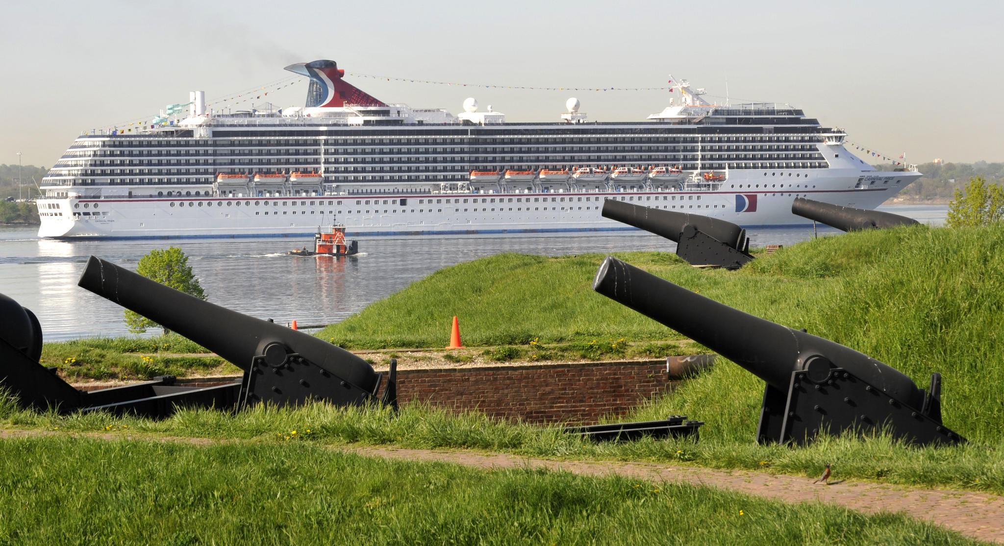 Carnival Cruise Line's ship Carnival Pride sails past the guns at Fort McHenry.