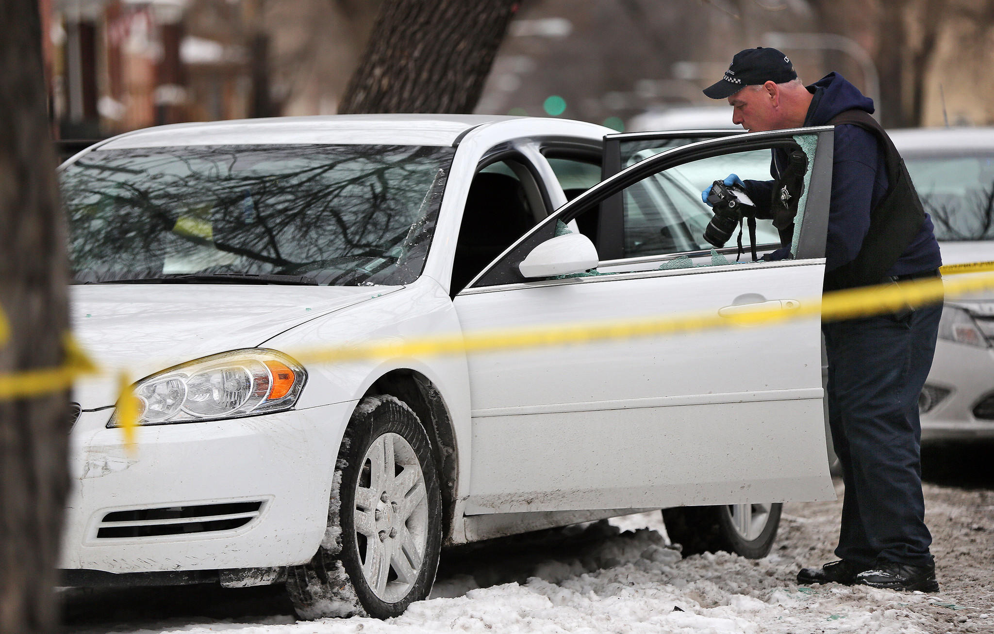 Chicago police investigate the scene near Augusta Boulevard and Hamlin Avenue where a 38-year-old man was wounded in a shooting.