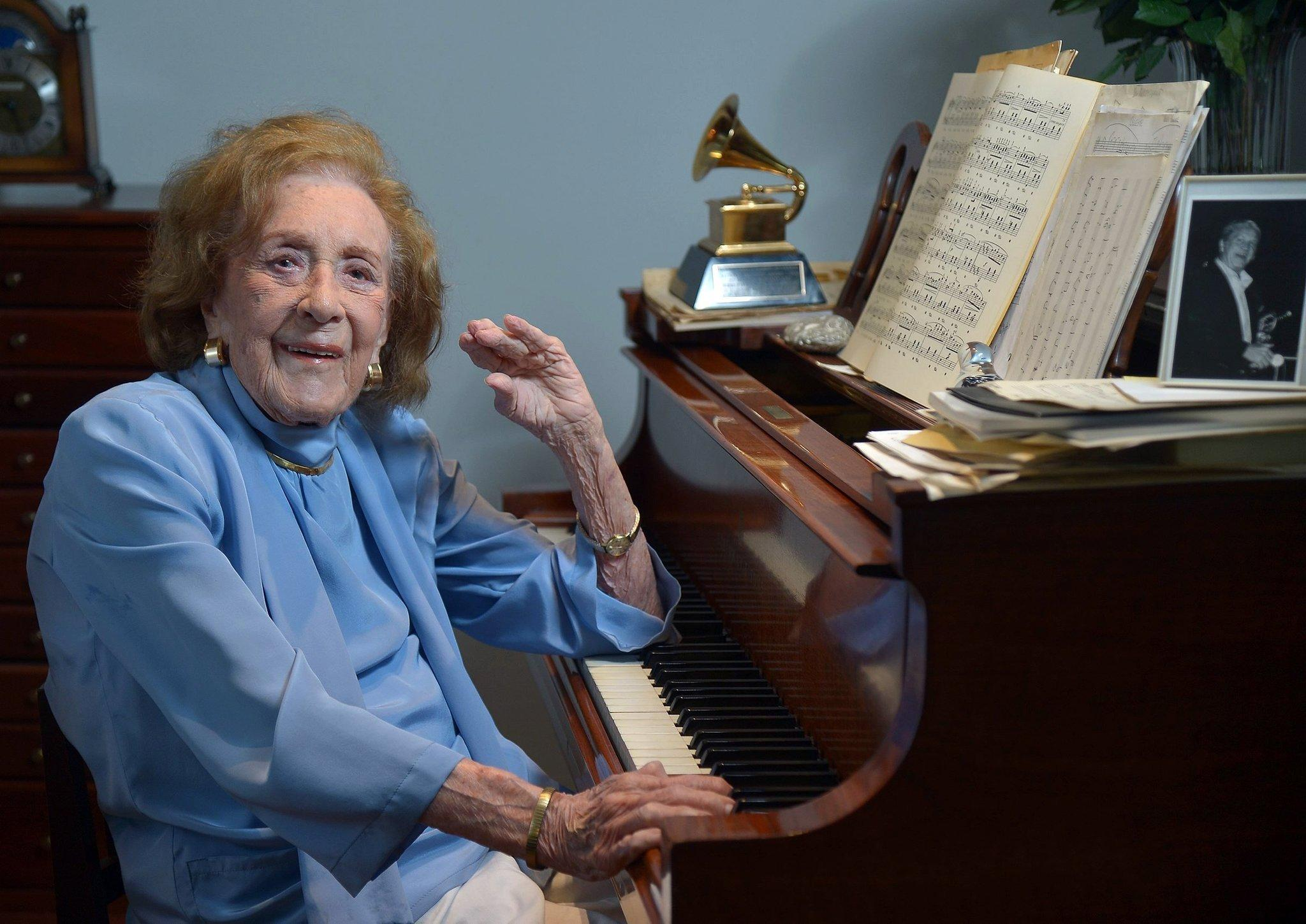 Jazz great Marian McPartland, 95, sits at the piano in her living room.