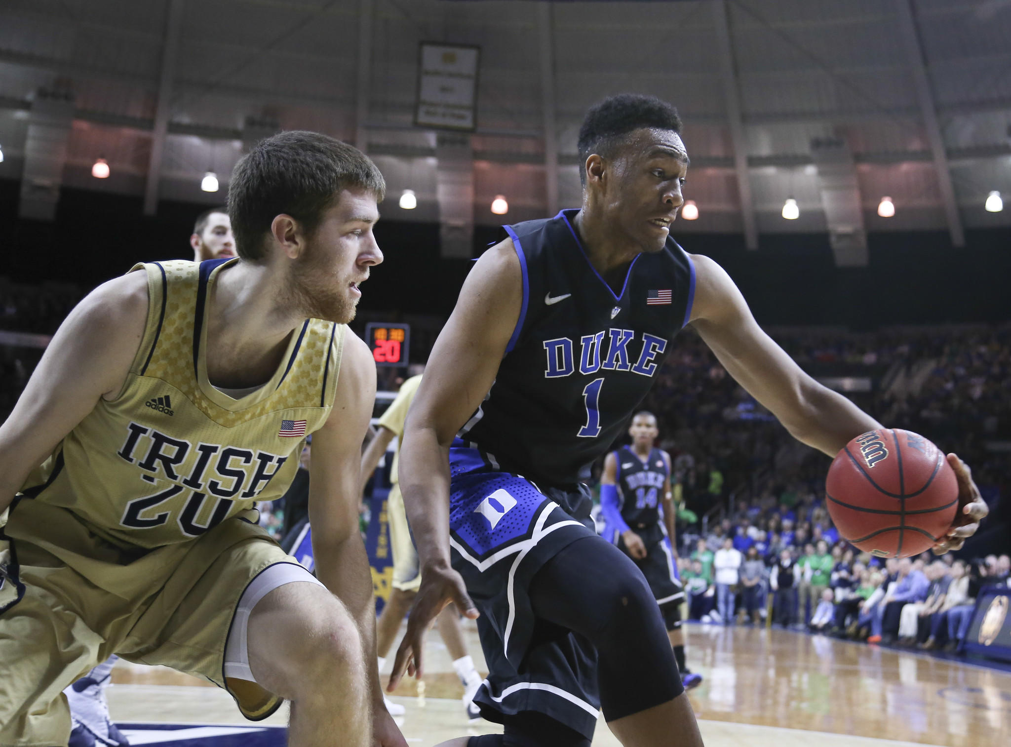 Duke Blue Devils forward Jabari Parker (1) drives around Notre Dame Fighting Irish forward Austin Burgett (20) during the first half of their game at the Purcell Pavilion at the Joyce Center.