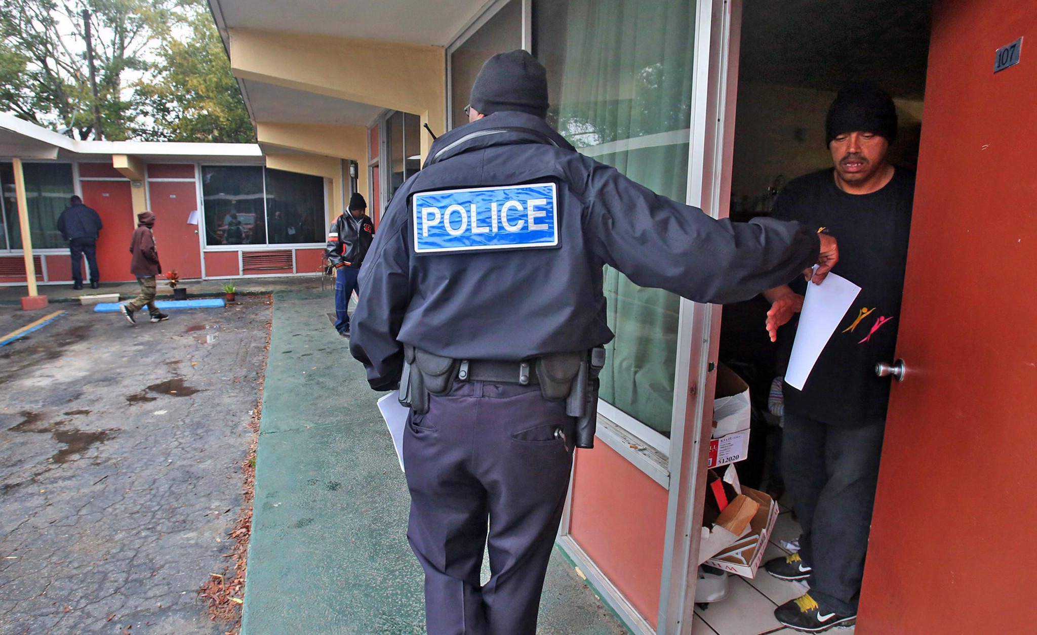 Eatonville Police serve eviction notices to residents Thursday who are left scrambling after an extended-stay motel in Eatonville is shut down on short notice.