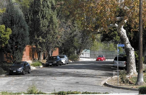 A few cars park on Houseman at Lilllian Court near the La Cañada Flintridge Towne Center on Saturday, Jan. 25, 2014. Restricted parking signs will be placed in this area.