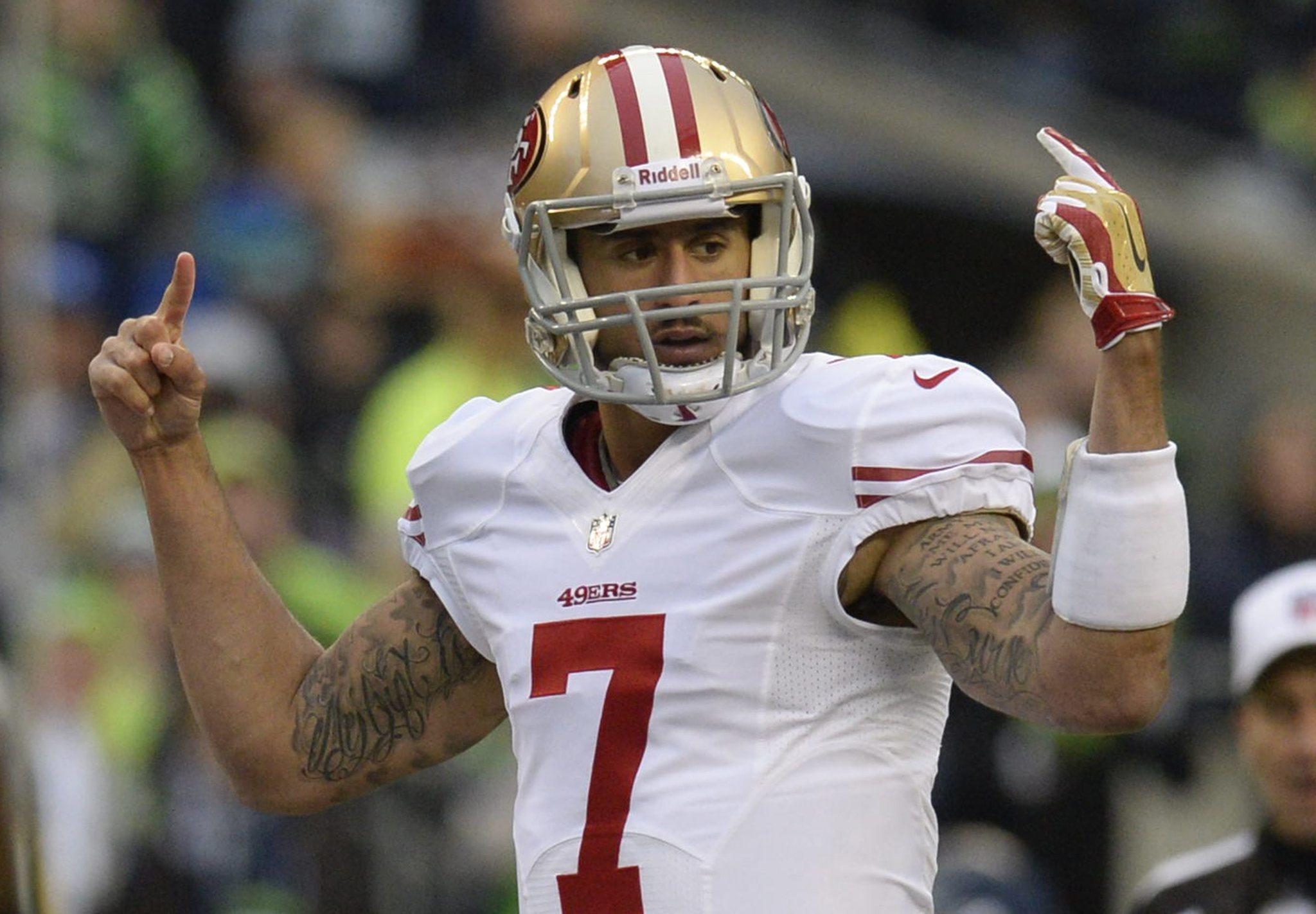 San Francisco 49ers quarterback Colin Kaepernick calls plays at the line of scrimmage against the Seattle Seahawks during the first half of their NFC Championship Game.