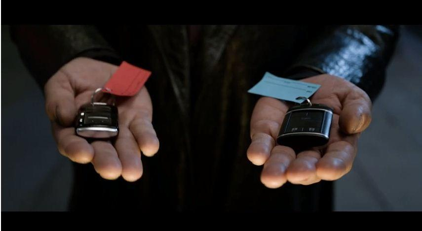 The hands of Morpheus from the Matrix offer up the blue key and the red key to Kia's K900 ad in Super Bowl XLVIII.