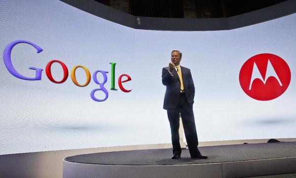 Google's chairman Eric Schmidt at a press conference in 2012 when Motorola introduced three new smartphones.