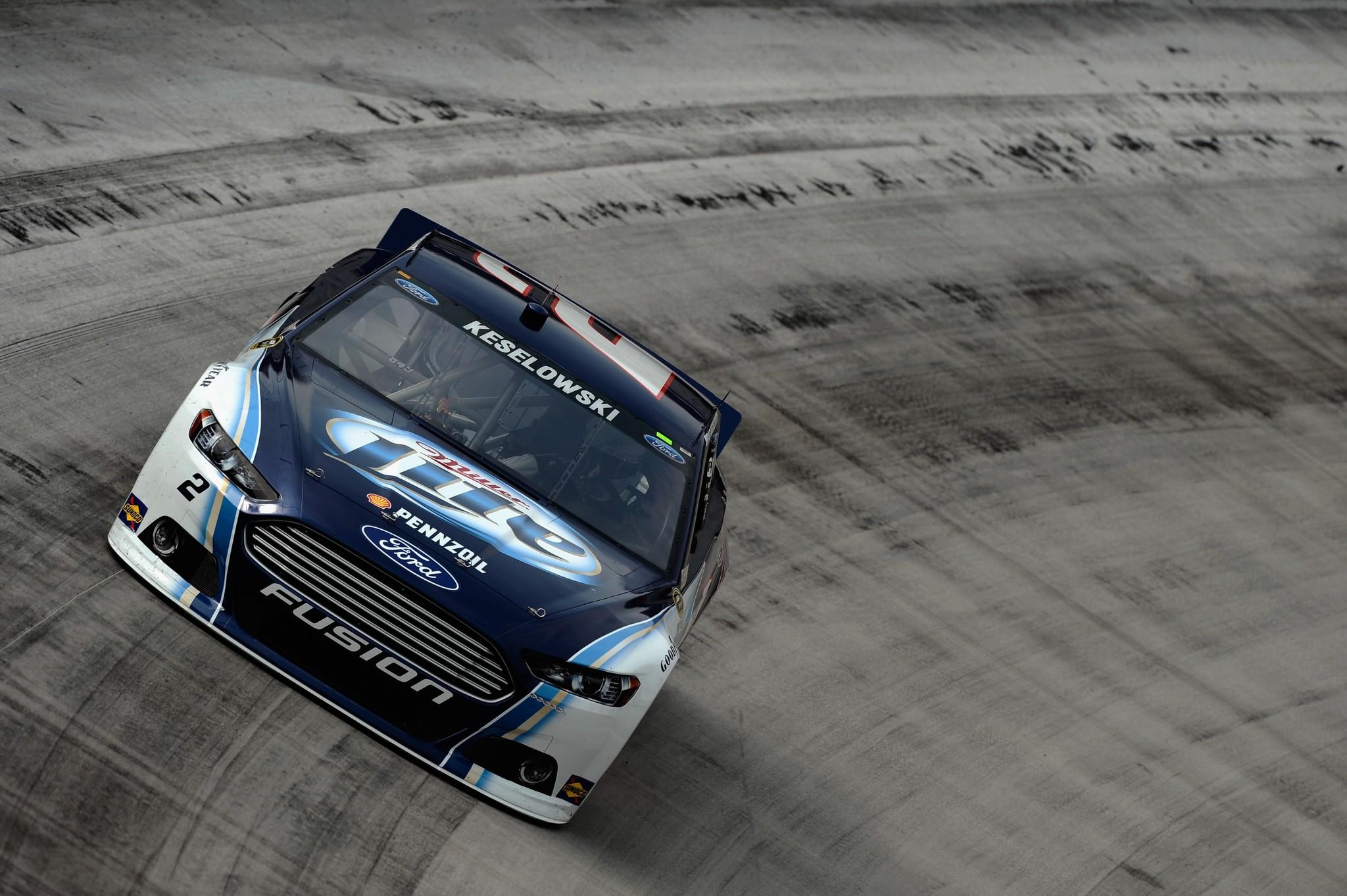 Brad Keselowski, driver of the #2 Miller Lite Ford, practices for the NASCAR Sprint Cup Series IRWIN Tools Night Race at Bristol Motor Speedway on August 23, 2013 in Bristol, Tennessee.