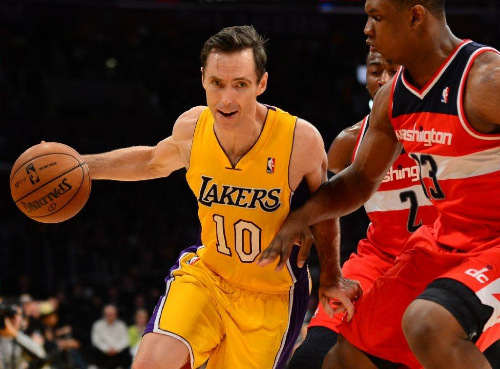 Steve Nash drives against Kevin Seraphin and John Wall of the Washington Wizards during a game last spring.