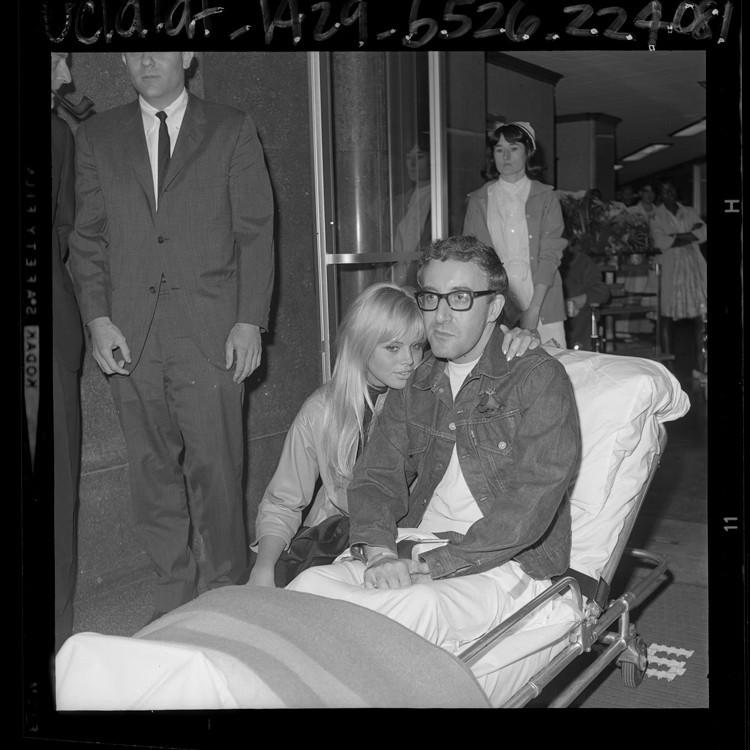 British comedian Peter Sellers, 38, stricken with a heart attack April 6, 1964, that almost cost him his life, gets a hug from his Swedish actress wife, Britt Eklund, 21, as he leaves Cedars of Lebanon Hospital (now Cedars-Sinai) on a litter.