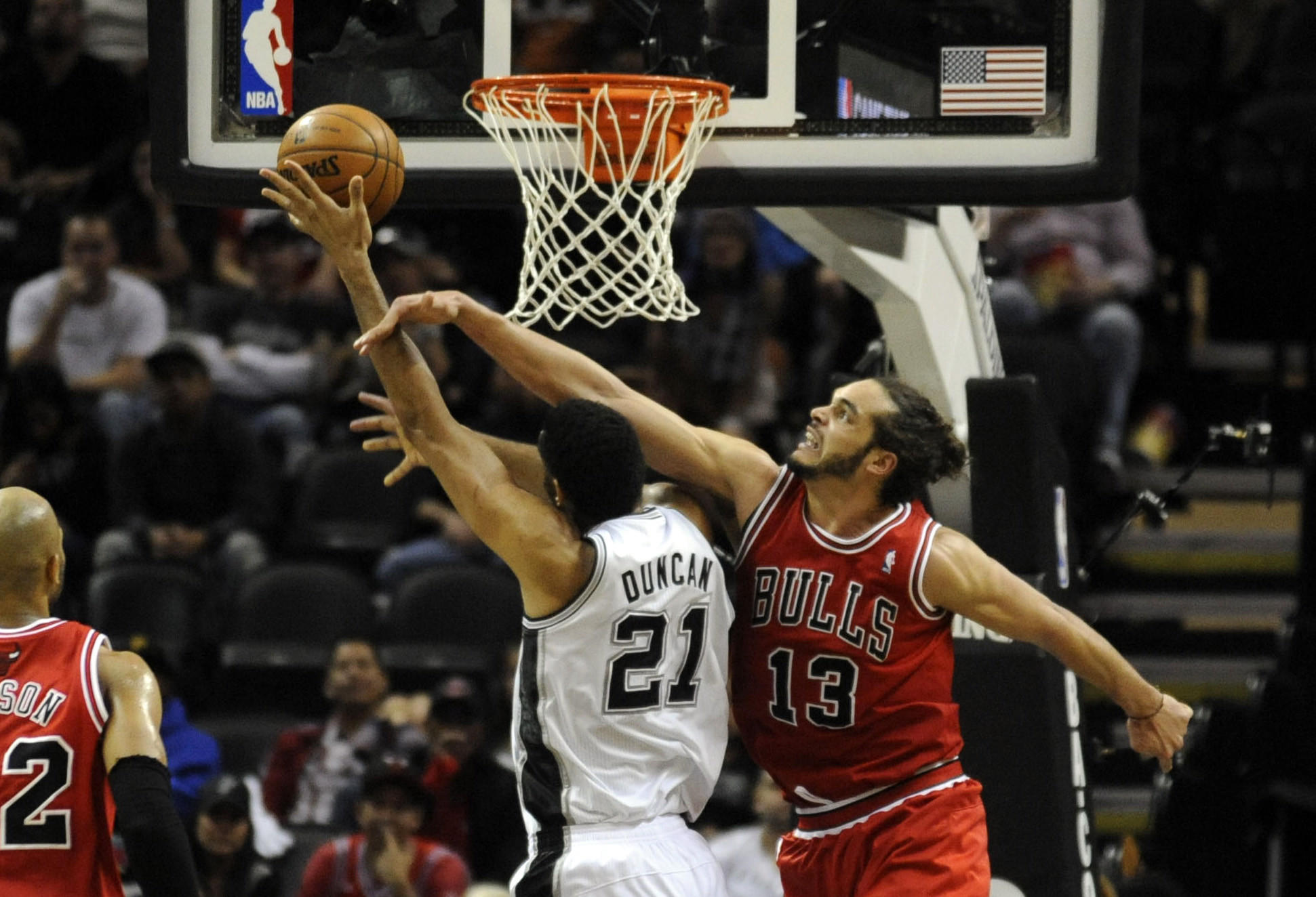 Bulls center Joakim Noah fouls San Antonio Spurs forward Tim Duncan during the second half at the AT&T Center.