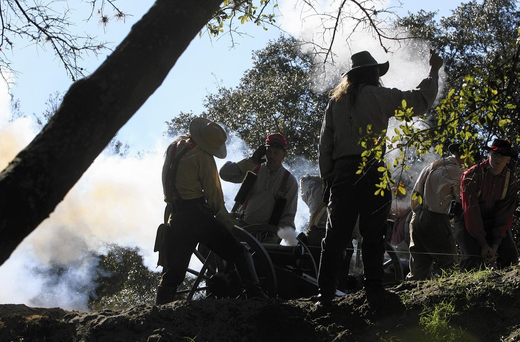 A Confederate light artillery unit fires a cannon Saturday. Civil War re-enactors took part in the annual Battle of Townsend's Plantation Saturday and Sunday at Renninger's Antique Center in Mount Dora.