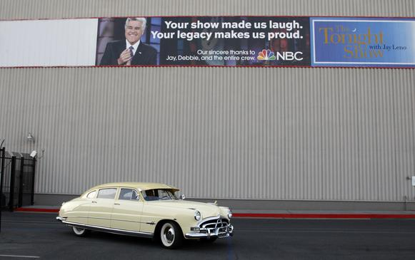 "Jay Leno arrives at the ""Tonight Show"" studios in a Hudson Hornet on Jan. 28, 2014, in Burbank. Leno has hosted the show from 1992 to 2009 and began his second tenure on March 1, 2010, and will end as host of the show on Feb. 6, 2014, ending 22 years as a talk show host."