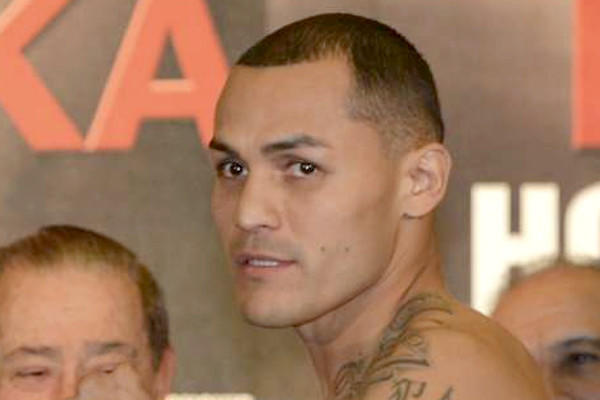 The manager-trainer for Mike Alvarado, above, says the boxer is planning to come to Los Angeles to train for a May fight.