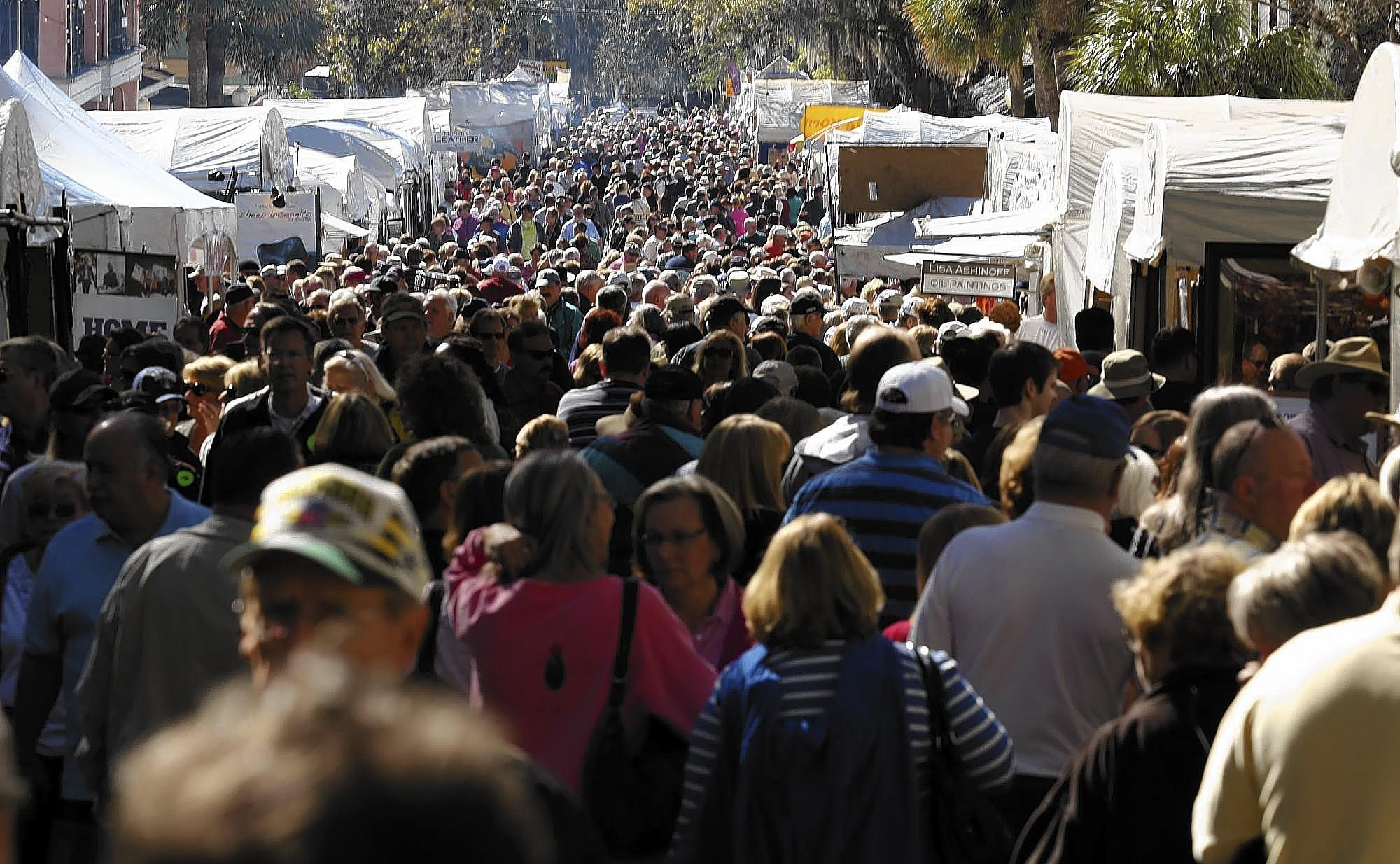 A sea of shoppers crowds Donnelly Street during the Mount Dora Arts Festival on Saturday, February 2, 2013.