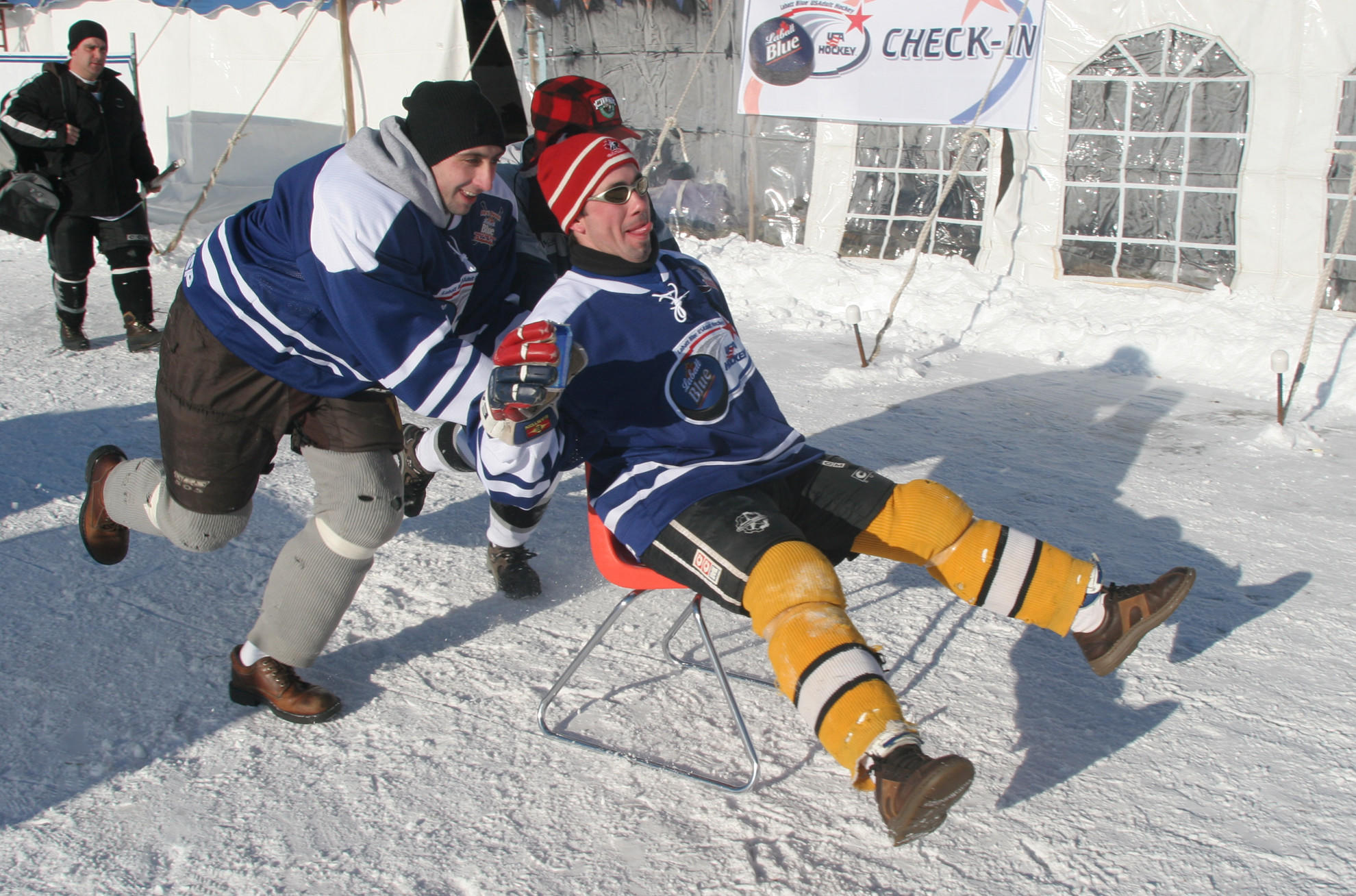Jason Schleinzer, left, from Elmhurst, pushes Tyson Boyer, from Downers Grove, as they relax after their pond hockey game on Feb. 18, 2006.