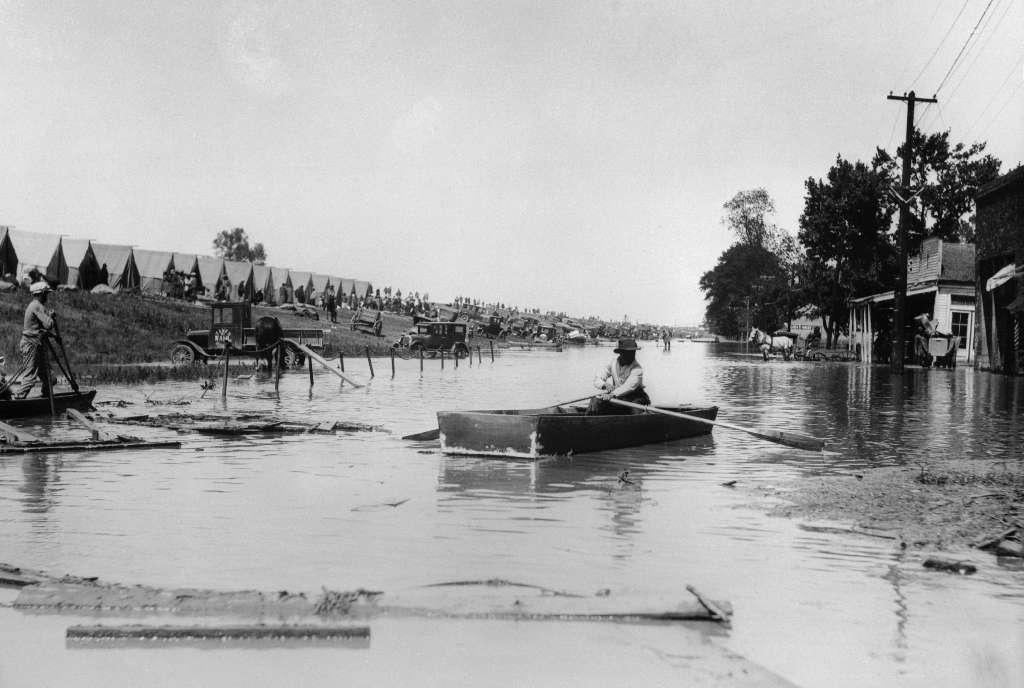 The overflowing waters of the Mississippi River conjured one of the worst floods in the history of the United States. This photo shows the scene in Greenville, Mississippi circa April 27, 1927.