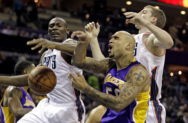 Lakers center Robert Sacre battles Bobcats big men Bismack Biyombo, left, and Cody Zeller for a rebound during a game earlier this season in Charlotte, N.C.